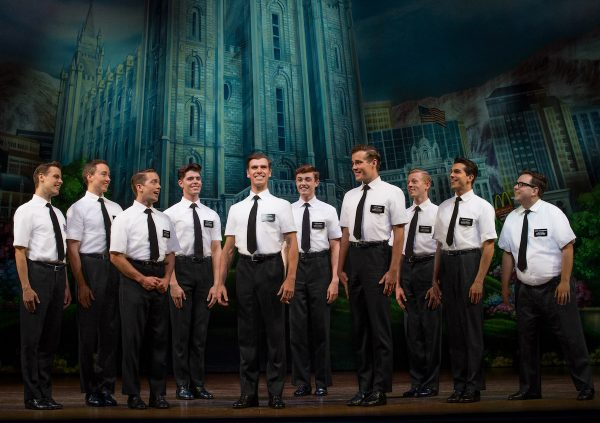 Blake Bowden, Nyk Bielak and ensemble in THE BOOK OF MORMON. Image Jeff Busby