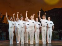 Joel Granger and Mormon Ensemble in THE BOOK OF MORMON. Image Jeff Busby